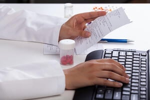 Pharmacists hands checking information about medicines